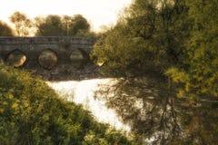 Beautiful sunrise landscape of image flowing under English medie Stock Image