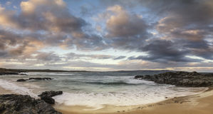 Beautiful sunrise landscape image of Godrevy in Corwnall England Stock Photos