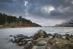 Beautiful Winter landscape image of Llynnau Mymbyr in Snowdonia. Beautiful sunrise landscape image in Winter of Llynnau Mymbyr in Snowdonia National Park with Royalty Free Stock Photo