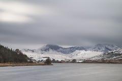 Beautiful Winter landscape image of Llynnau Mymbyr in Snowdonia Royalty Free Stock Photos