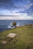 Beautiful sunrise landscape of Land's End in Cornwall England Stock Photo