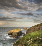 Beautiful sunrise landscape of Land's End in Cornwall England Stock Images