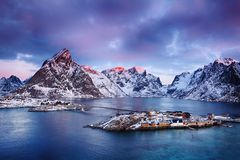 Beautiful sunrise landscape of picturesque fishing village in Lofoten islands, Norway. Beautiful sunrise landscape of picturesque fishing village in the stock photo