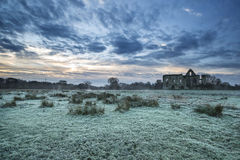 Beautiful sunrise landscape of Priory ruins in countryside locat Stock Image