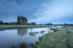 Beautiful sunrise landscape of Priory ruins in countryside locat Royalty Free Stock Image