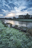 Beautiful sunrise landscape of Priory ruins in countryside locat Royalty Free Stock Photography