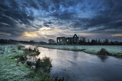 Beautiful sunrise landscape of Priory ruins in countryside locat Stock Photography
