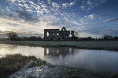 Beautiful sunrise landscape of Priory ruins in countryside locat Stock Photos