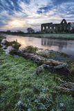 Beautiful sunrise landscape of Priory ruins in countryside locat Royalty Free Stock Photo