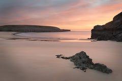 Beautiful sunrise landsdcape of idyllic Broadhaven Bay beach on Royalty Free Stock Photos