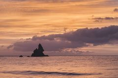 Beautiful sunrise landsdcape of idyllic Broadhaven Bay beach on Stock Photos