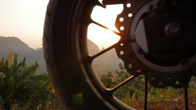 Beautiful Sunrise Lens Flare Thru Travel Motocycle Wheel with Amazing Thai Mountains. HD Slowmotion. Phang Nga Province. Beautiful Sunrise Lens Flare Thru stock footage