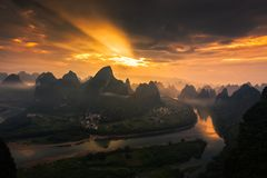 Beautiful sunrise on the li river. At four o`clock in the morning, carrying heavy photographic equipment, climbed to the top of the mountain. After more than two royalty free stock photo
