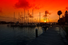 Beautiful sunrise marina. Red sky morning sunrise in the background of the clear water marina in Florida Stock Photo
