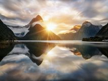 Beautiful sunrise in Milford Sound, New Zealand. Mitre Peak is the iconic landmark of Milford Sound in Fiordland National Park, South Island of New Zealand Stock Photo