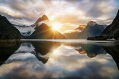 Beautiful Sunrise in Milford Sound, New Zealand. Mitre Peak is the iconic landmark of Milford Sound in Fiordland National Park, South Island of New Zealand stock images