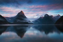 Beautiful sunrise in Milford Sound, New Zealand. Mitre Peak is the iconic landmark of Milford Sound in Fiordland National Park. stock image