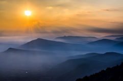 Beautiful sunrise, mist and mountains. At national park of thailand Royalty Free Stock Photo