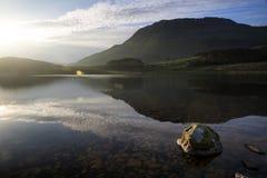 Beautiful sunrise mountain landscape reflected in calm lake Stock Photography