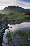 Beautiful sunrise mountain landscape reflected in calm lake Royalty Free Stock Photo