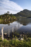 Beautiful sunrise mountain landscape reflected in calm lake Stock Photo