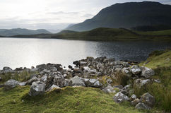 Beautiful sunrise mountain landscape reflected in calm lake Royalty Free Stock Photos