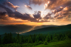 Beautiful sunrise in mountains, the sky in sunshine Stock Photography