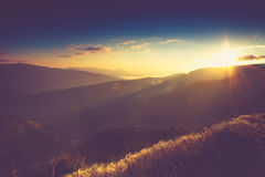 Beautiful sunrise in the mountains. Vintage filter Stock Photos
