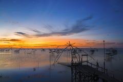 Beautiful sunrise. With net fishing at the lake stock image