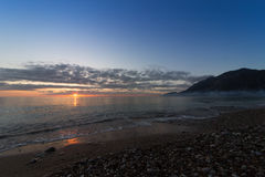 A beautiful sunrise on the ocean. Royalty Free Stock Image