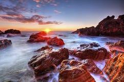 Free Beautiful Sunrise On Rocky Shore Royalty Free Stock Images - 67222469