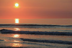 Beautiful sunrise with orange tints over the water Royalty Free Stock Image