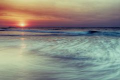 Beautiful sunrise over the beach stock images