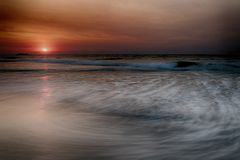 Beautiful sunrise over the beach royalty free stock photography