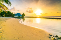 Beautiful sunrise over beach with the water villas in tropical M. Aldives island Royalty Free Stock Photo