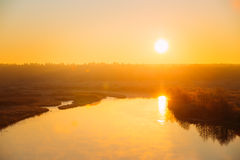 Beautiful Sunrise over Calm Lake, River in autumn Royalty Free Stock Images