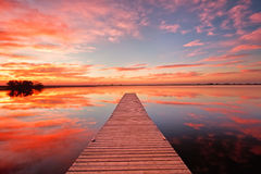 Beautiful sunrise over a Colorado fishing dock Royalty Free Stock Image