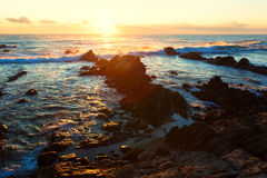 Beautiful sunrise over Cretaceous sedimentary rock coastline Stock Photography