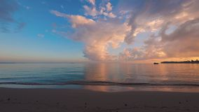 Beautiful sunrise over the exotic beach. Tropical sea waves under the blue sky. Beautiful sunrise over the exotic beach. Tropical sea waves under the blue sky stock video