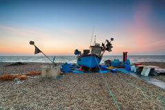 Beautiful Sunrise over a Fishing Boat Stock Photography