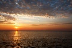 Beautiful sunrise over the horizon. Dramatic clouds Stock Image
