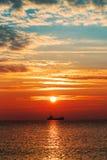 Beautiful sunrise over the horizon. Dramatic clouds Royalty Free Stock Image