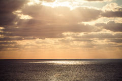 Beautiful sunrise over the horizon. Dramatic clouds Stock Images