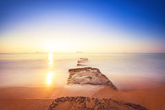 Beautiful sunrise over the horizon. And foggy waves Royalty Free Stock Images