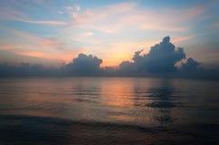 Beautiful sunrise over the horizon in the sea with clouds, Hua Hin, Thailand. Beautiful sunrise over the horizon in the sea with clouds and , Hua Hin, Thailand Stock Image
