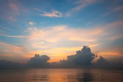Beautiful sunrise over the horizon in the sea with clouds, Hua Hin, Thailand. Royalty Free Stock Photos