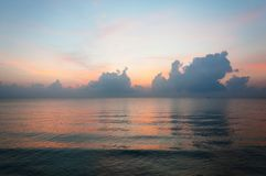 Beautiful sunrise over the horizon in the sea with clouds, Hua Hin, Thailand. Stock Photography