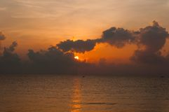 Beautiful sunrise over the horizon in the sea with clouds, Hua Hin, Thailand. Royalty Free Stock Images