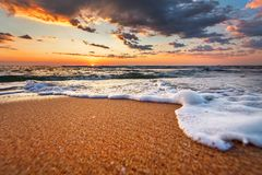 Beautiful sunrise over the horizon. Beautiful sunrise over the tropical beach Stock Photos