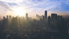 Beautiful sunrise over Jakarta city. JAKARTA - Indonesia. May 21, 2018: Beautiful sunrise over office building on Jakarta city Royalty Free Stock Photo